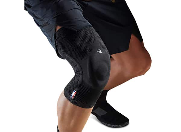 Bauerfeind GenuTrain NBA Knee Brace - Basketball Support with Medical Compression - Sleeve Design with Patella Pad Gel Ring for Pain Relief & Stabilization (Black, XL)